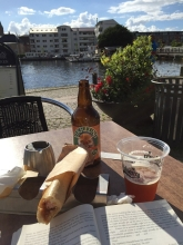 Hot dog, beer and a book in Silkeborg, Denmark